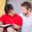 Young Couple Reading a Book Outside — Stock Photo