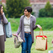 Young Women at Park after Shopping — Stock Photo