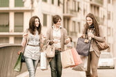 Three Beautiful Young Women with Shopping Bags — Stock Photo