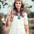 Hippie Portrait showing Peace Sign - Stockfoto