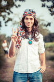 Hippie Portrait showing Peace Sign — Stockfoto