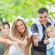 Happy Family Outdoor with Thumbs Up — Stock Photo