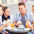 Happy Friends having a Traditional Italian Breakfast — Stock Photo #12586302