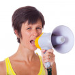 Young Woman Talking Through Megaphone - Stock Photo