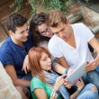 Group of Friends with Tablet PC — Stock Photo
