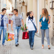Happy Girls With Bored Boys on Shopping — Stock Photo #12630354