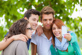 Group of Friends taking Self Portrait with Mobile — Stock Photo