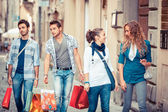 Happy Girls With Bored Boys on Shopping — Stock Photo