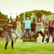 Multicultural College Students Jumping — Stock Photo