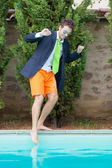 Young Businessman with Swimming Trunks next to the Pool — Stock Photo