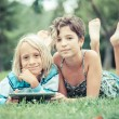 Stock Photo: Couple of Children with Tablet PC