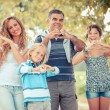 Happy Family with Heart Shaped Hands — Stock Photo #12697047