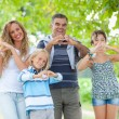 Happy Family with Heart Shaped Hands — Stock Photo
