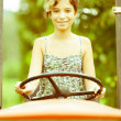 Little Girl on the Tractor — Stock Photo #12697050