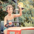 Little Girl on the Tractor — Stock Photo