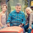 Adult Farmer with Children on Tractor — Stock Photo #12697059
