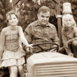 Adult Farmer with Children on Tractor — Stock Photo