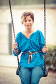Young Girl Playing on the Swing — Stock Photo