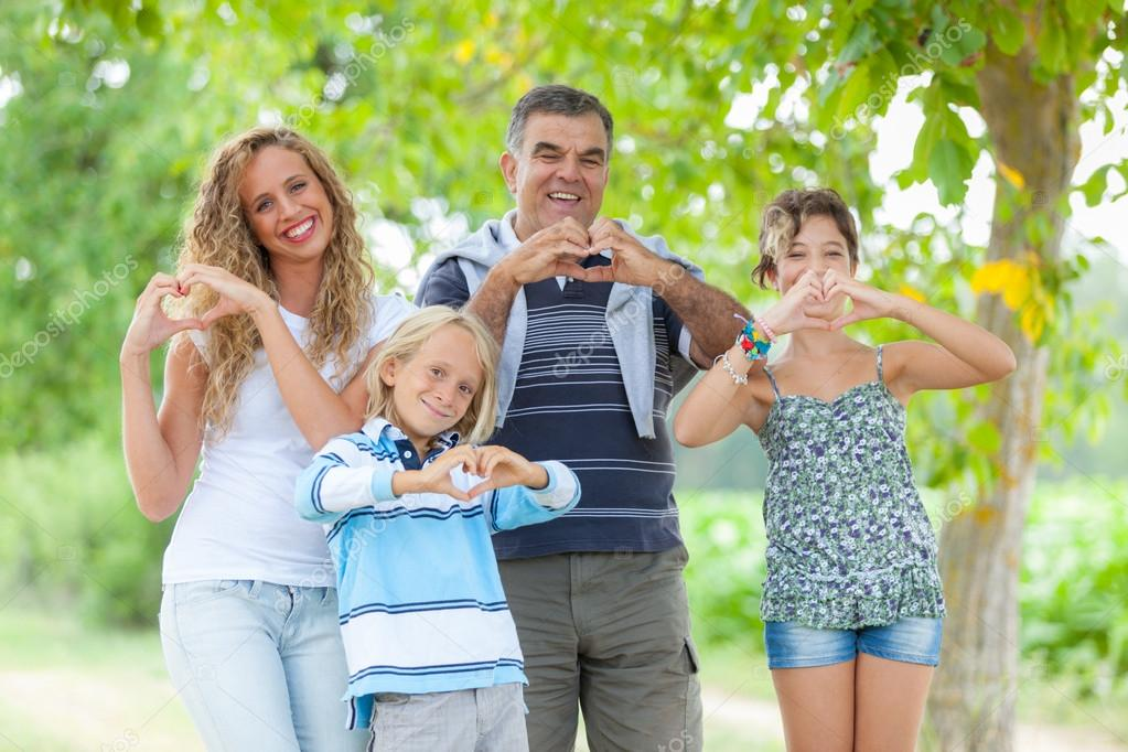 Happy Family with Heart Shaped Hands — Stock Photo #12697048