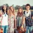 Hippie Group Walking on a Countryside Road — Stock Photo #12702039