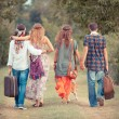 Hippie Group Walking on a Countryside Road — Stock Photo #12702041