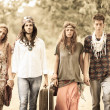 Hippie Group Walking on a Countryside Road — Stock Photo #12702047