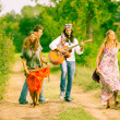 Hippie Group Playing Music and Dancing Outside — Stock Photo #12702056