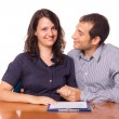 Happy Young Couple with Important Document to Sign — Stock Photo #12702070