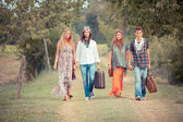 Hippie Group Walking on a Countryside Road — Stock Photo