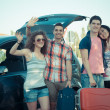 Four Friends Ready to Leave For Vacation — Stock Photo #12749292