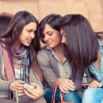 Three Women Looking Photos in the Camera — Stock Photo