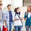 Happy Girls With Bored Boys on Shopping — Stock Photo #12749162