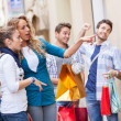Happy Girls With Bored Boys on Shopping — Stock Photo #12749169