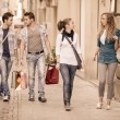 Happy Girls With Bored Boys on Shopping — Stock Photo #12749206