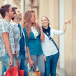 Happy Girls With Bored Boys on Shopping — Stock Photo #12749220