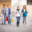 Happy Girls With Bored Boys on Shopping — Stock Photo #12749246