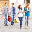 Happy Girls With Bored Boys on Shopping — Stock Photo #12749330