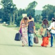 Hippie Group Walking on a Countryside Road — Stock Photo #12841882