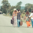 Hippie Group Walking on a Countryside Road — Stock Photo #12841897