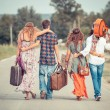 Hippie Group Walking on a Countryside Road — Stock Photo #12841910