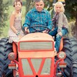 Adult Farmer with Children on Tractor — Stock Photo #12841956