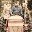 Adult Farmer with Children on Tractor — Stock Photo #12841979