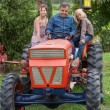 Adult Farmer with Children on Tractor — Stock Photo #12841996