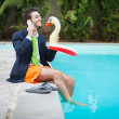 Funny Young Businessman with SwimmingTrunks next to the Pool — Stock Photo #12857861