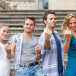 Stock Photo: Group of Friends showing Obscene Gesture