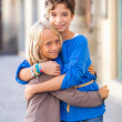 Stock Photo: Little Boy and Girl Embraced