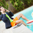 Funny Young Businessman with SwimmingTrunks next to the Pool — Foto de Stock