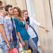 Happy Girls With Bored Boys on Shopping — Stock Photo #12871589