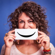 Stock Photo: Young Womwith Smiley Emoticon
