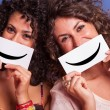 Two Young Women with Smiley Emoticon on Blue Background — Stock Photo #13172337